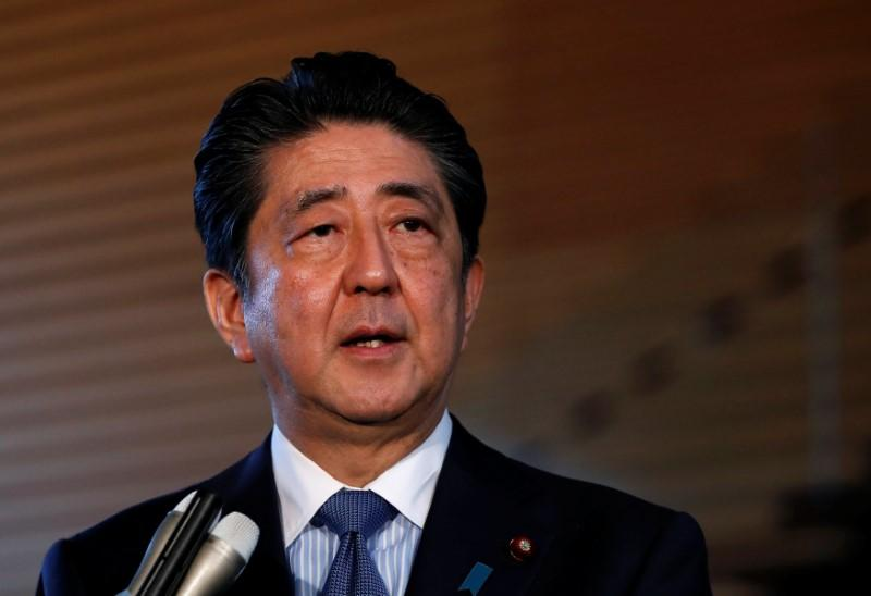 China invites Japan's prime minister to visit – Reuters