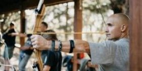 An Australian man shoots an arrow but a smartphone is replaced