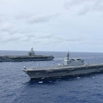 Japan's largest warship joins US carrier for military exercises in disputed South China Sea – The Japan Times